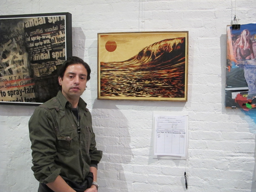 "Jamie Martinez had the wining bid for the Shepard Fairey painting ""Dark Wave/Rising Sun"""