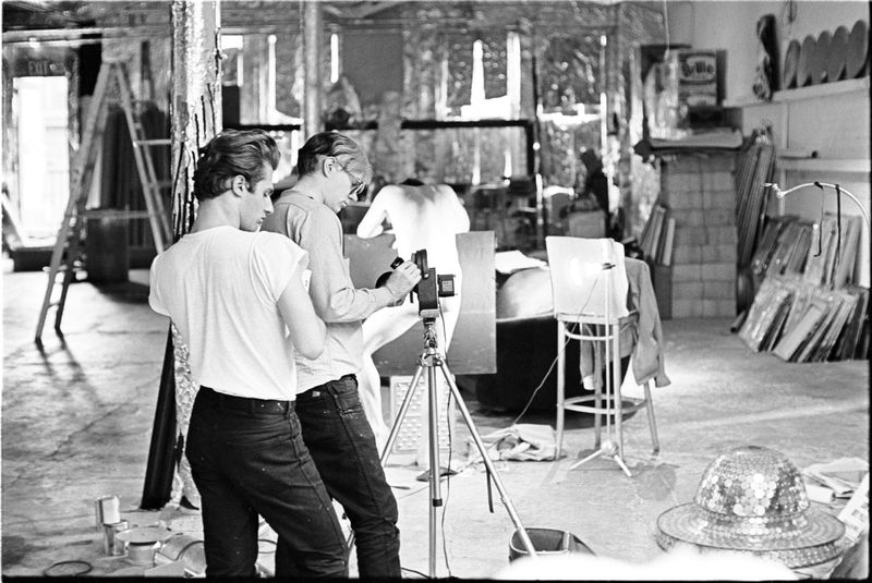 Andy Warhol with assistant Gerard Malanga filming Taylor Mead by William John Kennedy
