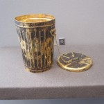 """James ROSENQUIST """"Calyx Krater Trash Can"""" 1976 18K gold 4 x 3 x 3 inches (trashcan) 3 inch diameter (lid)  $65,000 at Richard L. Feigen & Co."""