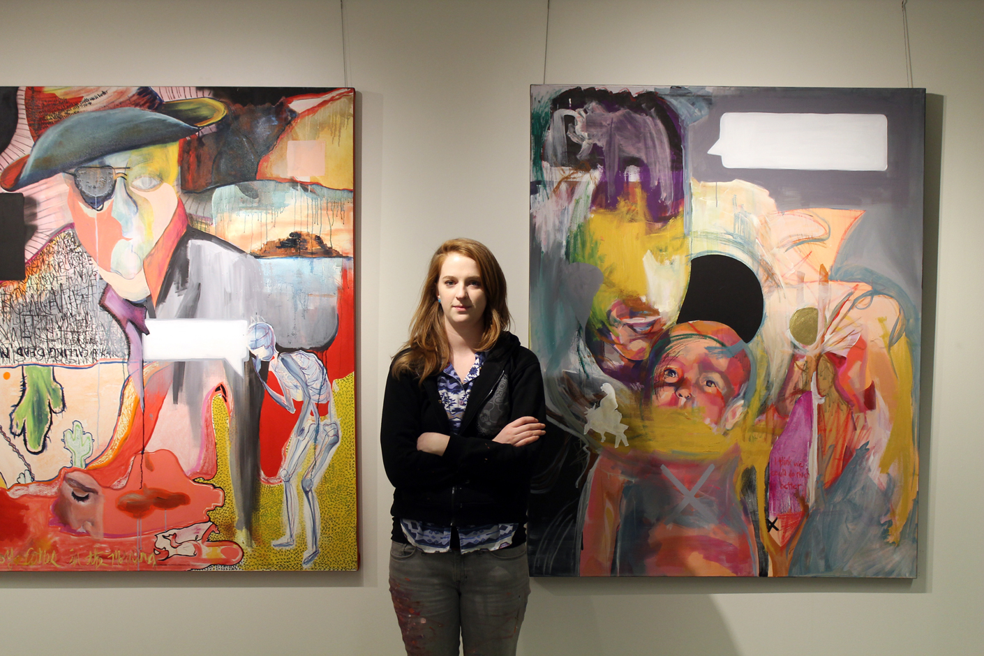 Amy Hughes Braden in front of her work
