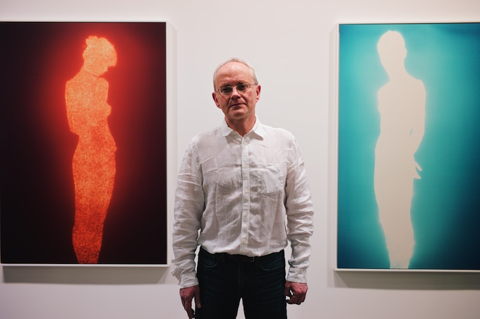 Artist Christopher Bucklow between his works