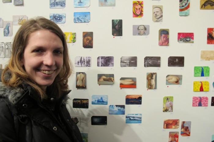 Artist Colleen Blackard next to her work