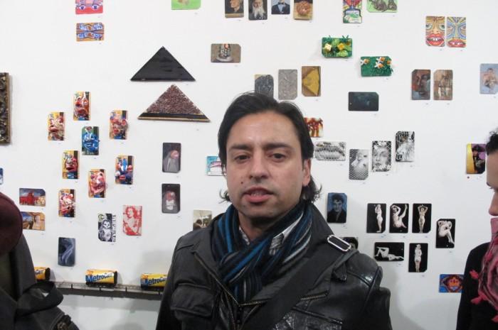 Artist Jamie Martinez next to his work