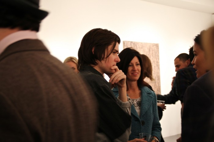 Artist Garrett Pruter in the middle of the buzz at his opening reception