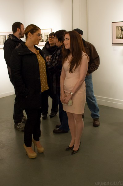 Photographer Melissa Cacciola (R) talks with guests at UPI