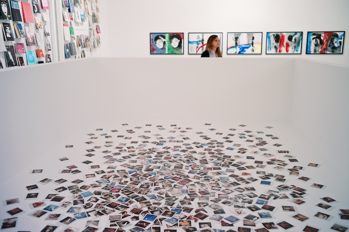 500 Polaroids of Araki amidst the published books and works on view