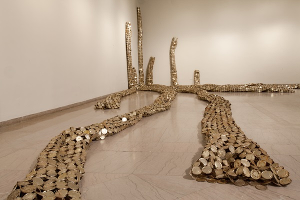 El Anatsui (Ghanaian, born 1944). Drainpipe, 2010. Tin and copper wire, installation at the Akron Art Museum, dimensions variable. Courtesy of the artist and Jack Shainman Gallery, New York. Photograph by Andrew McAllister, courtesy of the Akron Art Museum.