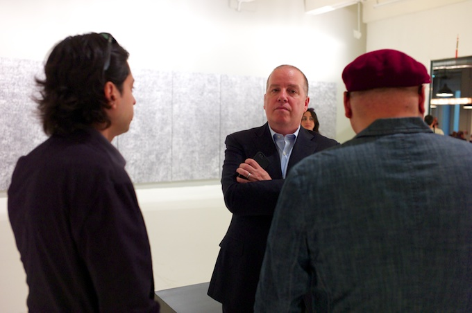 Eugene Lemay (center) welcomes the AF crew to Mana Contemporary