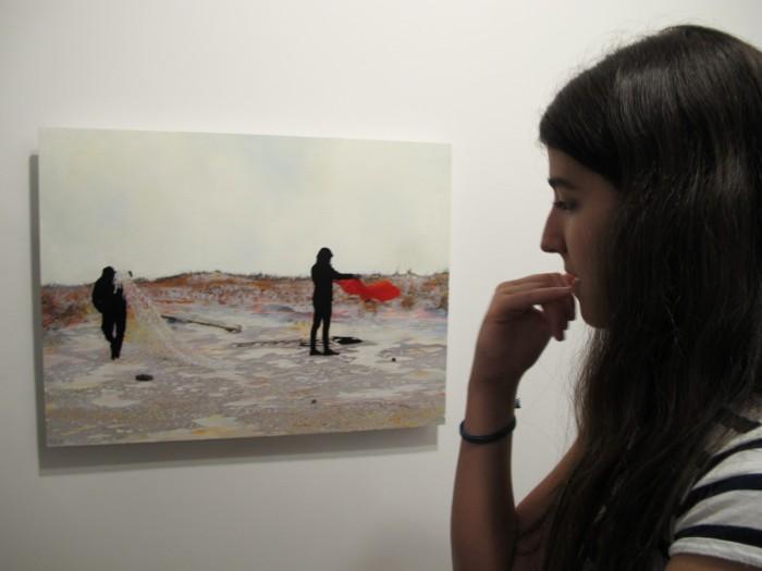 An engrossed viewer of Bradley Castellanos art