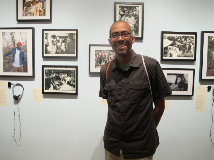 Artist Gerard Gaskin next to his photos
