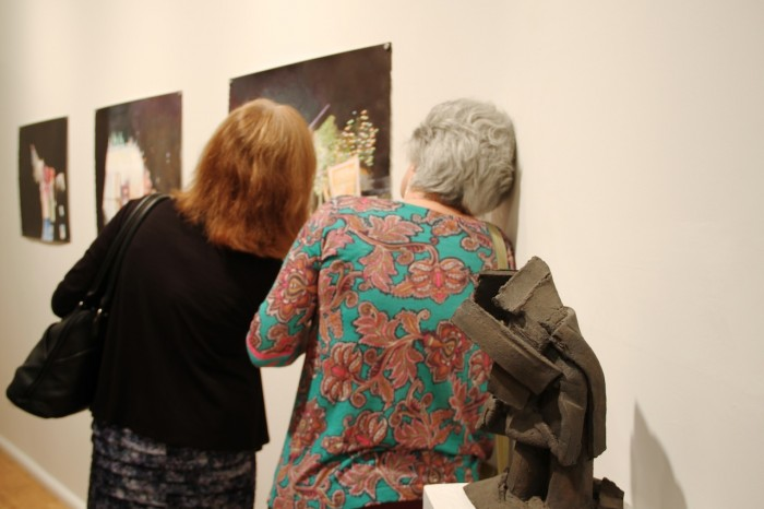 Synchronized Perusing of art at William Holman Gallery