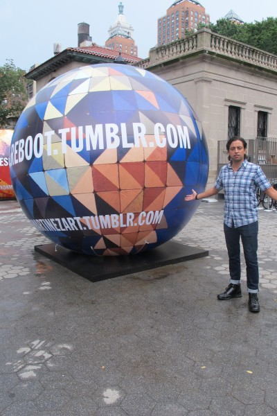 Artist Jamie Martinez next to his work