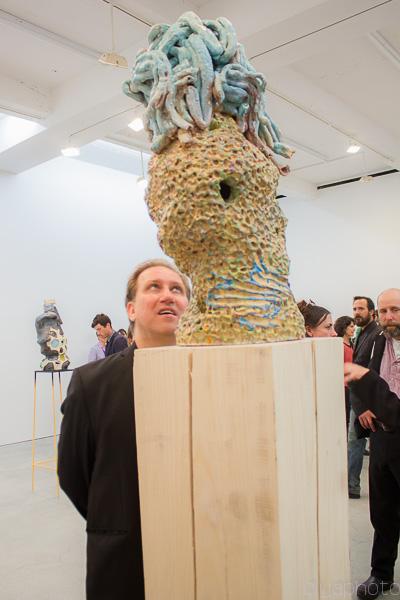 Artist Mark Kostabi viewing the sculpture of Arlene Shechet