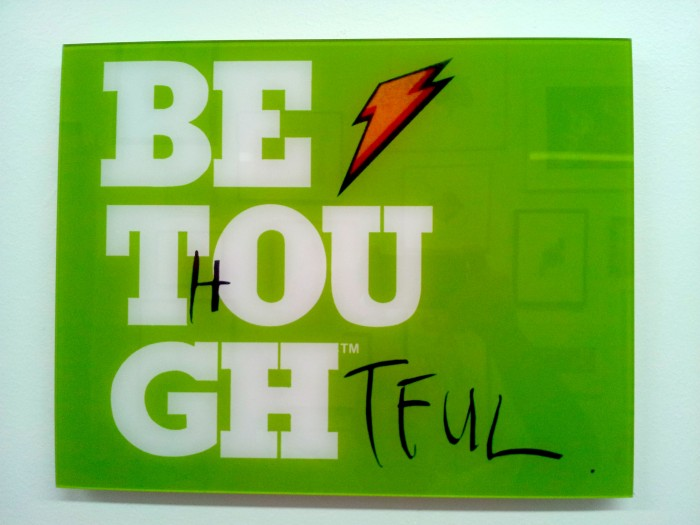 Be Thoughtful, 2010, paint marker, subway poster intervention,