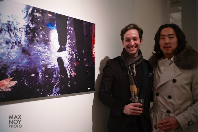 Artist Brian Reed (on left) attends the Maurice Renoma opening at BDG