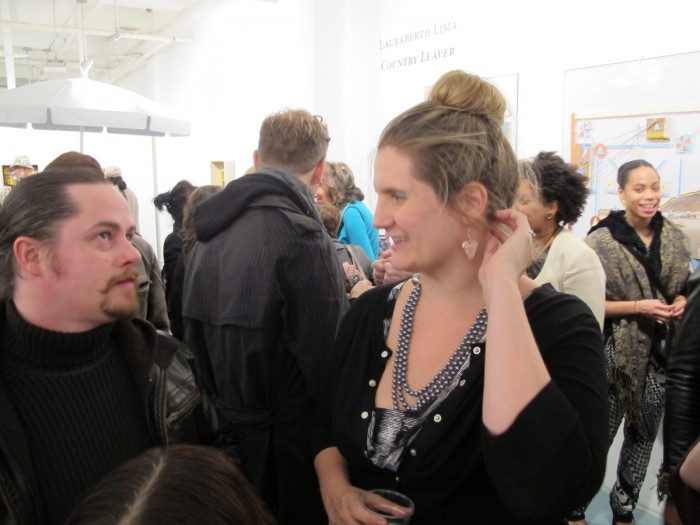 Director of Rush Galleries Charlotte Mouquin talking to guests