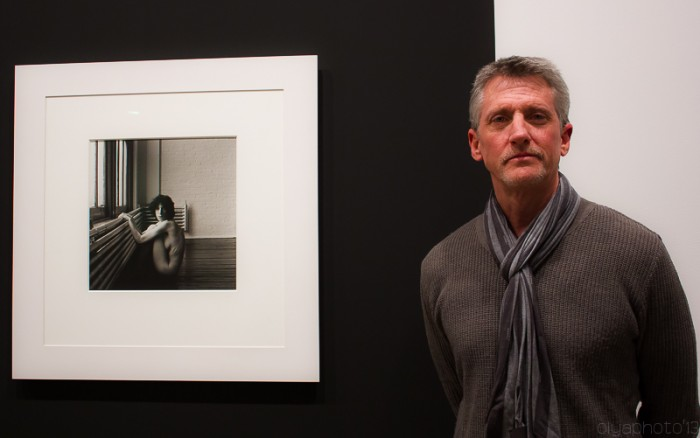 Edward Mapplethorpe, brother of Robert poses in fornt of his iconic photos