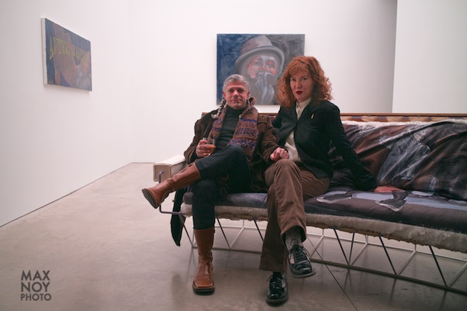 The artist Ena Swansea (R) with a guest lounging about at her opening