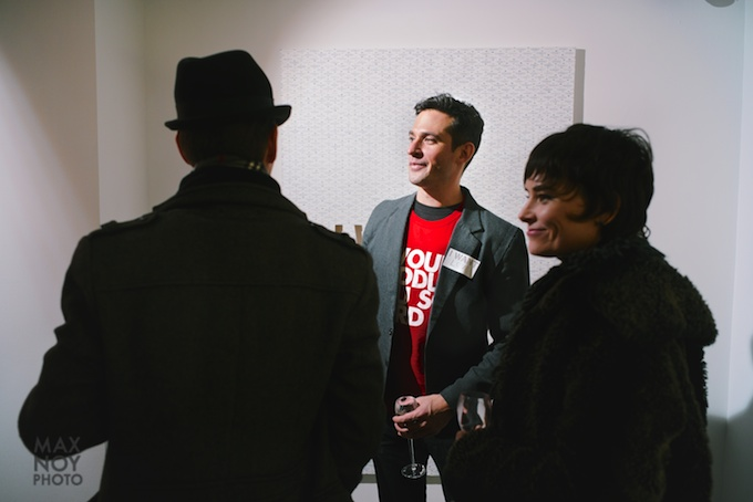 Artist Jonathan Rosen (center) at the opening in ROX Gallery