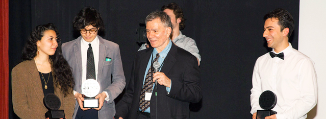 Filmmaker Bobby Babak Andishmand receiving the Manny award from executive producer Asher Bar Lev.