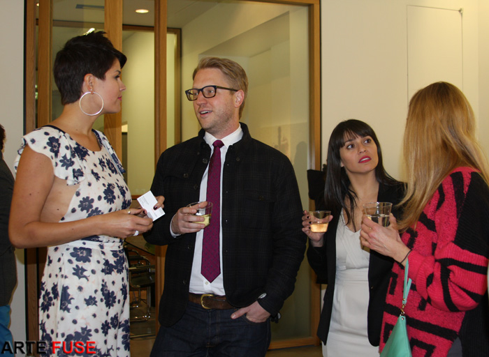 (L) Artist Lisa Alonzo with guests at her opening