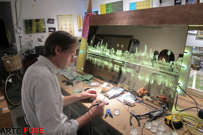 Eric working on a new price in front of Angkor Wat, Late After Sunset, a back lit sandblasted image on bronze mirror