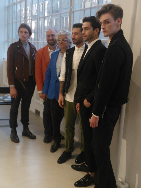 Alexander Gray (in orange jacket) with the designer and models