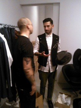 Designer Joshua Katcher (R) shows off his collection
