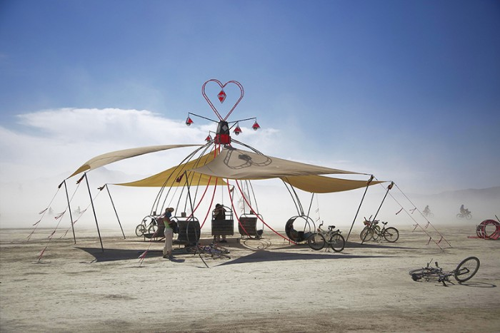 Dream Swing, Joe Beal (image by Evan Novis) This giant, glowing heart-topped Dream Swing has been coming to the desert since 2012. This installation is about infusing the innocence and joy of childhood into adult lives and relationships.