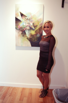 Hueman with one of her works
