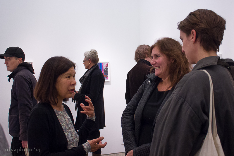 Mary Lum (L) talks with her guests