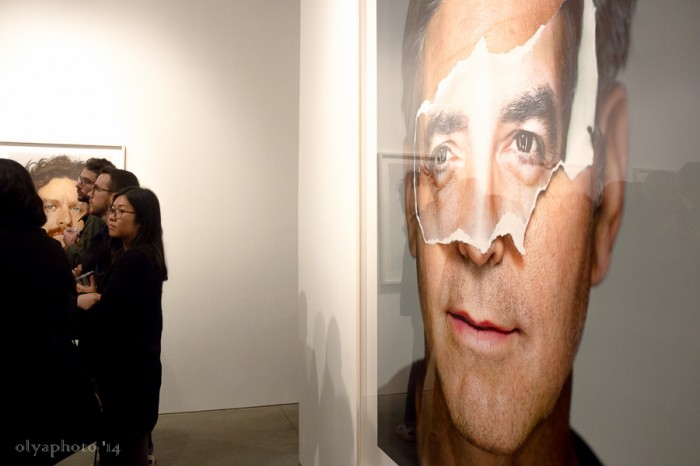 George Clooney takes in the reception buzz at HASTED KRAEUTLER