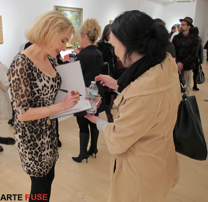 Artist Cristina Vergano signing her new book for a fan