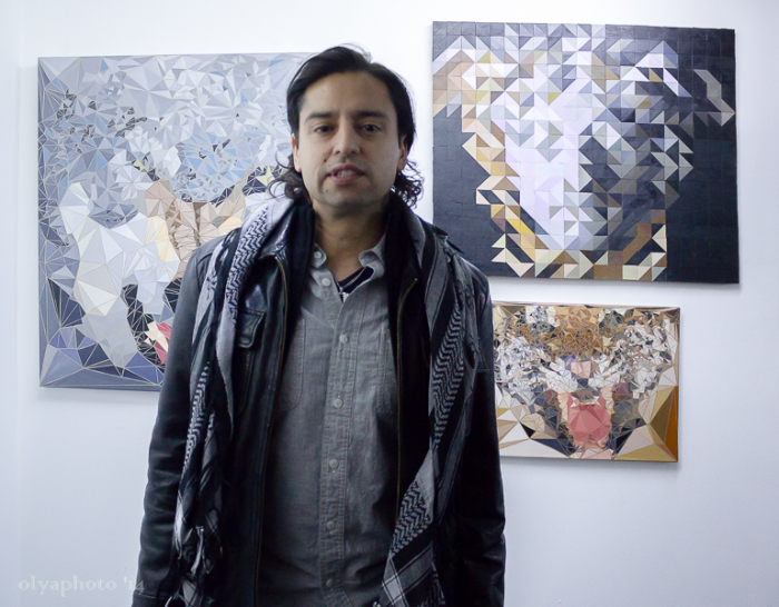 Artist Jamie Martinez in front of his triangulism paintings