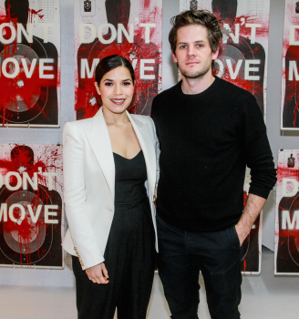 "Artist Ryan Piers Williams with his wife America Ferrera at his opening for ""Monsters and Landsacpes"" photo by Moises DePena"