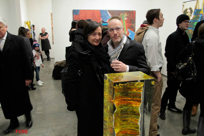 Bradley Hart (center right) amidst guests at his opening