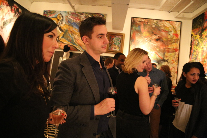 Guests enjoying the art scene at the Art Factory