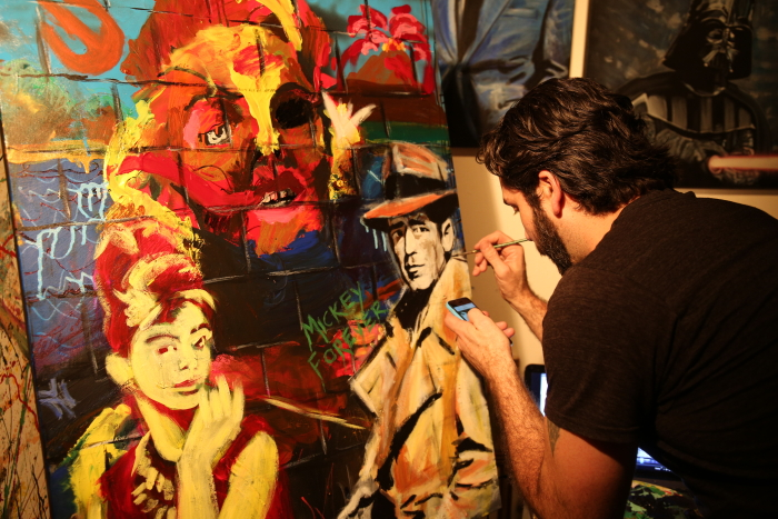 Aritst Craig Mahoney putting the final touches on the painting