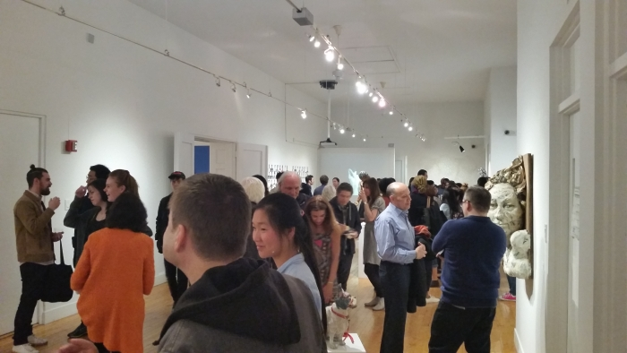 The crowd at the opening of Repsychling Group Exhibition