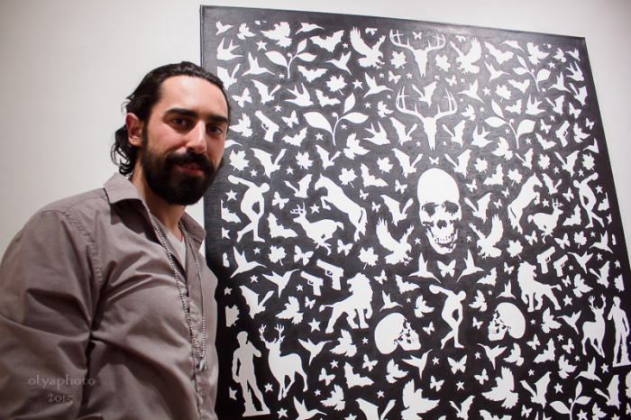 Artist Joseph Grazi in front of his painting