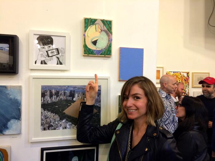 Artist Kelly Worman with her work