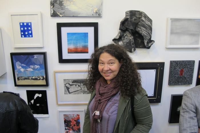 Artist Olya Turcihin next to her photograph