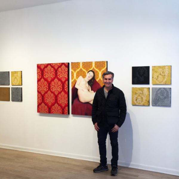 Artist Vincent Zambrano in front of his Paintings.