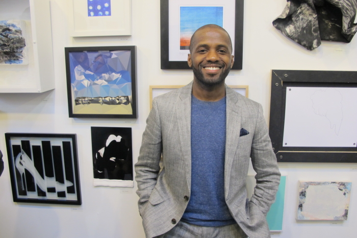 Co-curator of Making History Dexter Wimberly at the opening