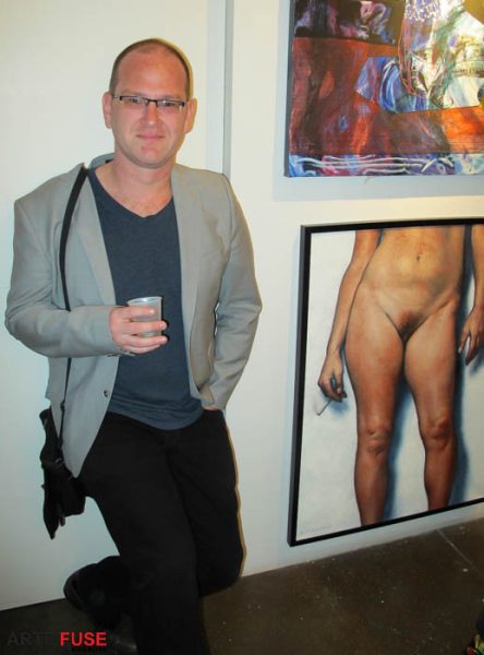 Artist Daniel Maidman with his gorgeous painting