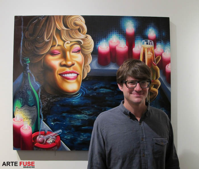 Artist Tom Sanford with his painting of Whitney Huston