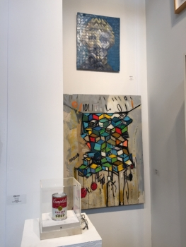(L-R) Andry Warhol, Carly Ivan Garcia and Jamie Martinez at the booth of Zener Schon for Art Market San Francisco