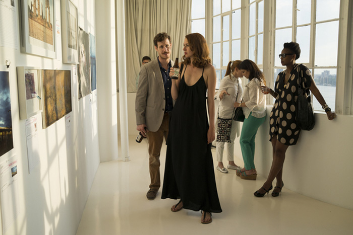 L-R) Edmond Caputo (artist) with Holly Shawhan (Corcoran), with Wangechi Mutu in background (artist, honoree)