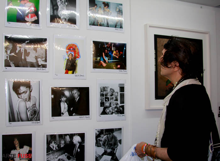 "A guest enjoying photographs from the ""The Last Pary"""