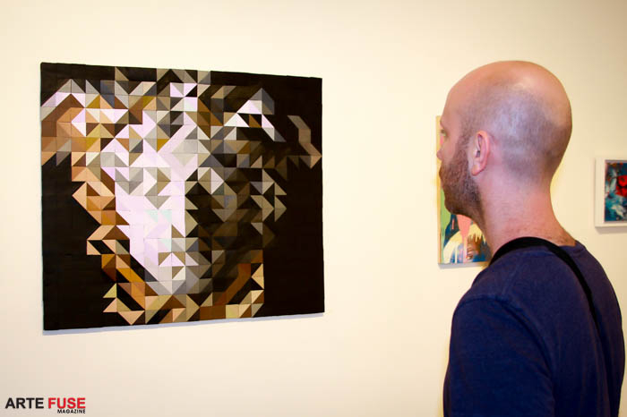 A guest admiring the work of Arte Fuse's publisher Jamie Martinez